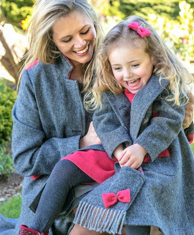 Ladies and Girls matching tweed grey herringbone coat with raspberry contrast panels. 100% Lambswool