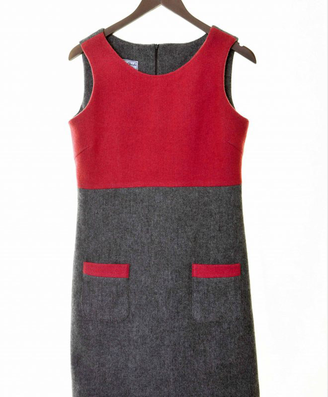 Ladies grey herringbone and raspberry tweed empire line dress €139 Fully lined, with patch pocket detail 100% Lambswool Size XS - XL FRONT VIEW